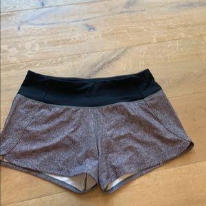 Heathered grey Lululemon speed up shorts.